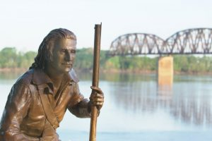 Life-size bronze statue of John James Audubon overlooking the Ohio River with the Henderson railroad bridge in background