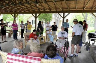 Supporters gather in the pavilion of the Brain Injury Adventure Camp near Robards for the presentation of a $50,000 grant from the Creative Ministries Committee of Presbyterian Women in the Presbyterian Church. They plan on using the money for shelters and bridges on their trail system and for foot and hand powered trikes for the campers. (Gleaner photo by Mike Lawrence • 831-8346 or mlawrence@thegleaner.com) 05-09-2011