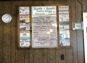 The old-fashioned board of daily specials at North South including a plate lunch for $7.29