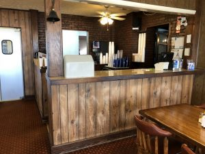 Details of brick and wood veneer at North South Truck Stop Cafe