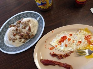 Bacon, eggs with hot sauce, and sausage gravy from Geneva Store. Photo by Brad Staton.