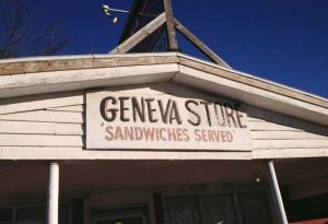 "Hand painted sign reading, ""Geneva Store, Sandwiches Served,"" photo by Brad Staton"