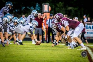 Henderson County High Football team ready for defense as the opponents prepare to hike. Photo by: Thru-a-lens photography